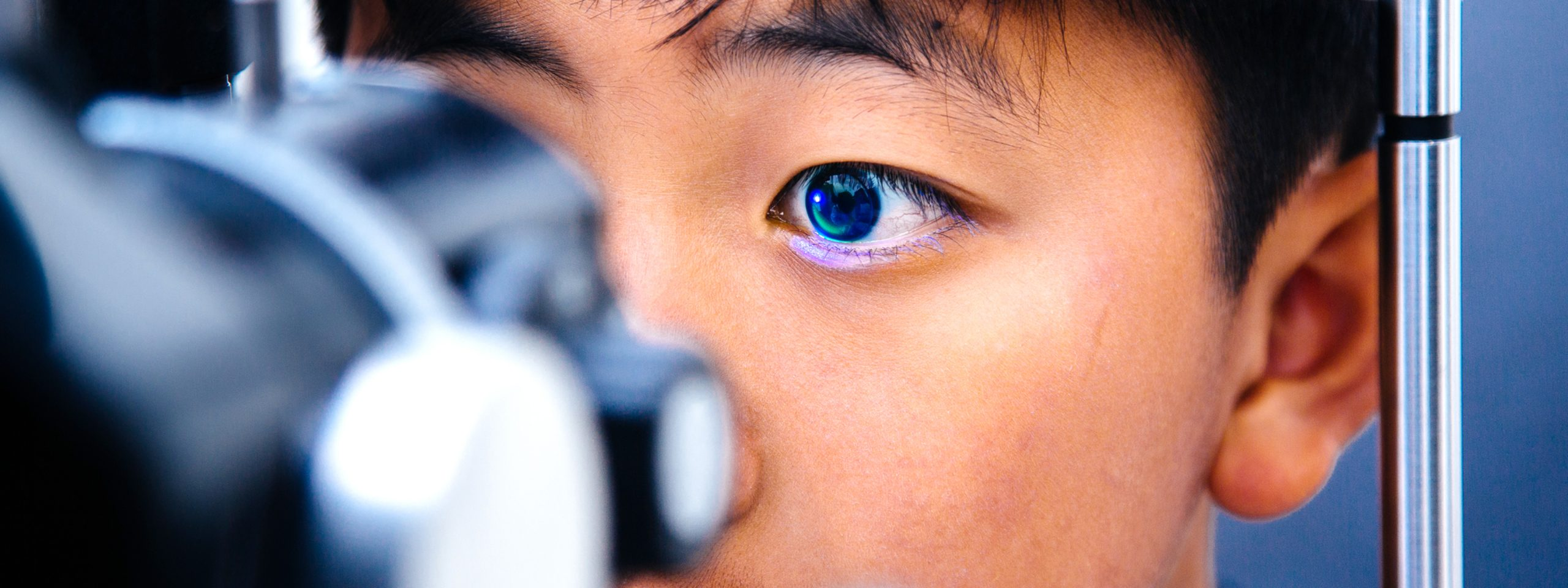 young male patient getting an eye exam