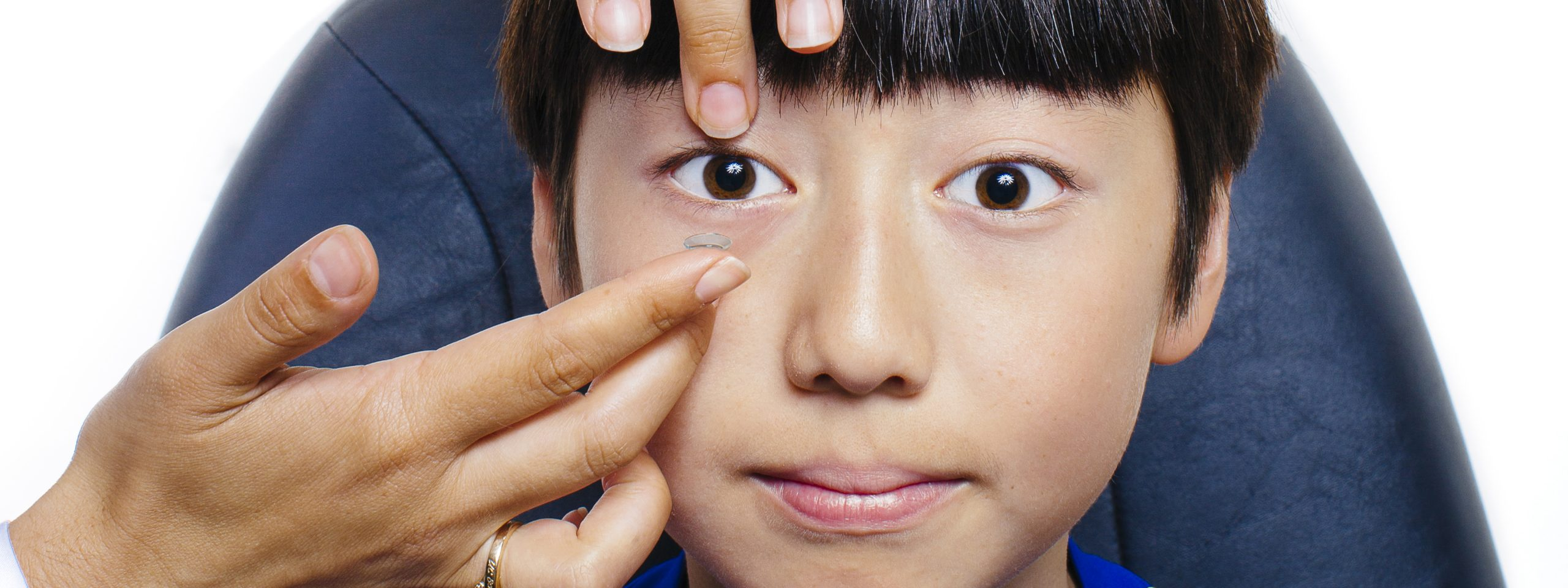 young male patient getting fitted for contact lens.